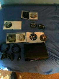 black Sony PS3 super slim console with controller and game Manassas, 20109