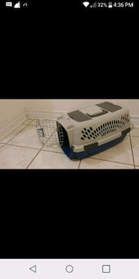 white and blue pet carrier screenshot 514 km