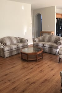 Living room set. 2 love seats, 2 wingback chairs and a coffee table.  Henderson, 89052