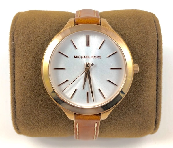 round gold Michael Kors analog watch with brown leather strap 0