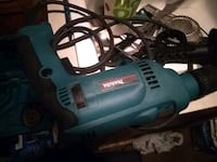 green and black Makita corded power tool Midway, 31320