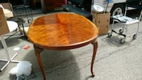 round brown wooden table with two chairs Mississauga, L5E 1E2