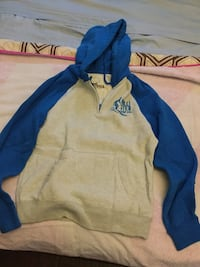 Hollister blue and light grey pull over hoodie size medium  Toronto, M6E 1Y2