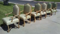 four brown wooden framed white leather padded armchairs Las Vegas, 89107