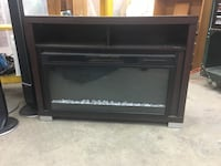 black wooden framed electric fireplace Central Okanagan, V4T 1H9