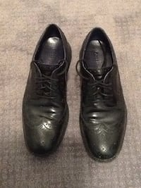 Pair of black leather oxford wingtip dress shoes