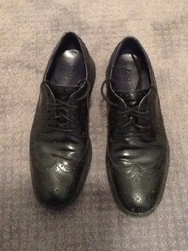 Pair of black leather oxford wingtip dress shoes 7480ad05-b3d5-41a6-bdc5-7b01cd37beac