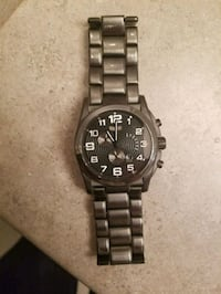 round black chronograph watch with silver link bra Langley Township, V2Y 1P3