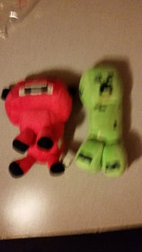 two green and red cartoon character plush toys 3716 km