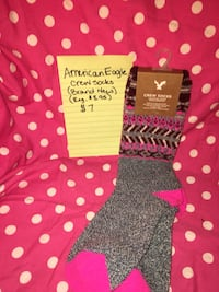 pair of gray-and-pink American Eagle crew socks