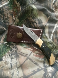 black and brown handled knife with sheath Toronto, M8W 3Z7