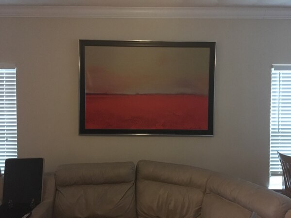 Red field abstract painting with frame ee78fa6f-fb97-47a0-9755-935742597579