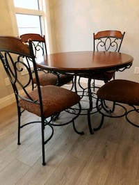 round brown wooden table with 4-piece chairs Edmonton, T6W