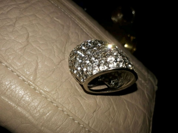 silver-colored and diamond ring