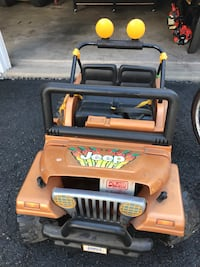 Toddler's brown and black jeep ride on toy car