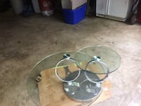 round gray metal base with clear glass-top coffee table