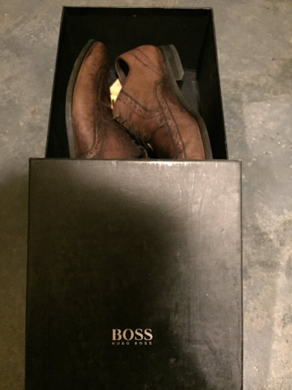 pair of brown Hugo Boss wingtip shoes with box f782ece0-082c-4c80-ac2c-88a580e39ded