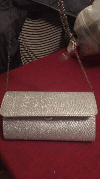 Brand New Silver Glitter Purse with Chain Handle that can be hidden or used. Plenty of room inside along with small pocket. Smoke Free Minneapolis