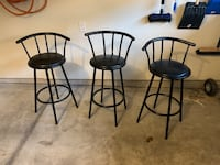 Three black metal bar stools 517 km