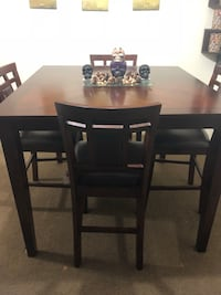 rectangular brown wooden table with four chairs dining set Canton