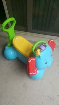 baby's blue and green ride on toy Laurel