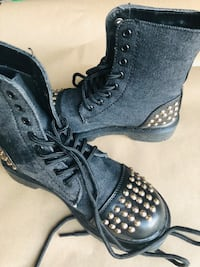 pair of black leather cap toe boots with silver studs 2241 mi