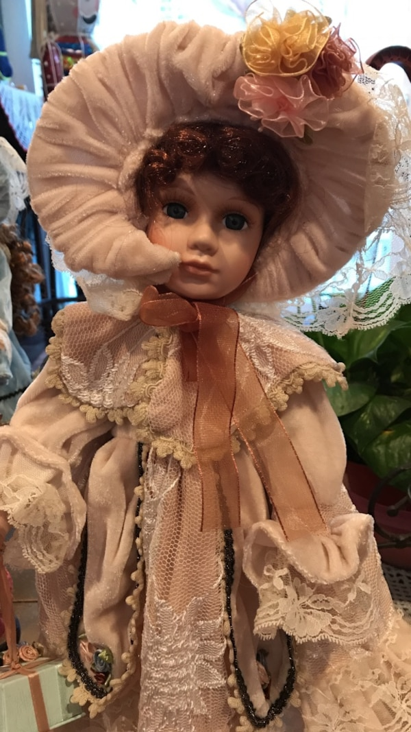 white dressed bisque doll