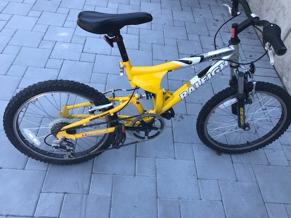 Yellow and black full-suspension bike