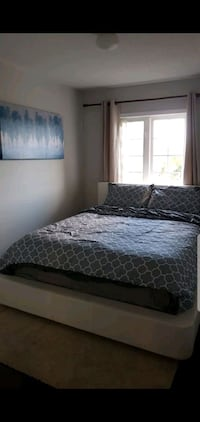 Queen size bed frame (real leather)--with box Mississauga, L4W 4K2