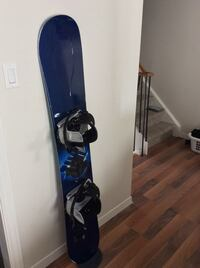 Blue and black snowboard with bindings Bradford, L3Z 1N2