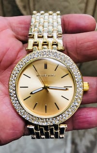round gold-colored analog watch with link bracelet Lake Worth, 33467