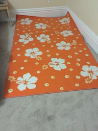 orange and white floral area rug
