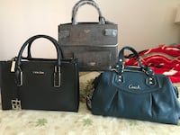 three black, gray, and blue tote bags