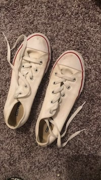 Pair of white converse all star low top sneakers Lubbock, 79424