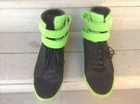 pair of black-and-green high-top sneakers
