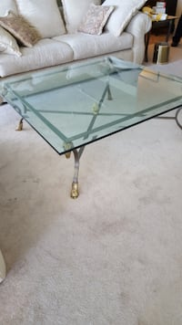 Thick glass top square coffee table brass accents Las Vegas