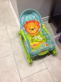baby's blue and green Fisher Price bouncer