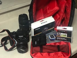 Black canon dslr camera with bag