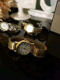 round gold analog watch with gold link bracelet Montréal, H1G 4X8