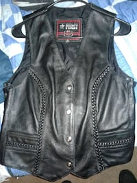 Black leather vest.