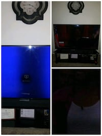 black flat screen TV; black wooden TV stand Temple Hills, 20748