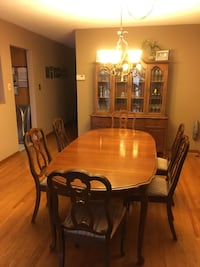 oval brown wooden dining table with chairs Mississauga, L4Y 3Z4