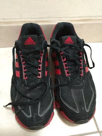 pair of black-and-red Adidas sneakers