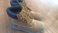 pair of brown Timberland work boots 53 km