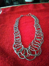 silver-colored ring loop necklace