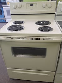 beige Whirlpool electric coil range oven Clayton, 27520