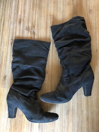 pair of black leather knee-high boots Laval, H7R 4V2
