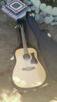 brown and black acoustic guitar Englewood, 80111