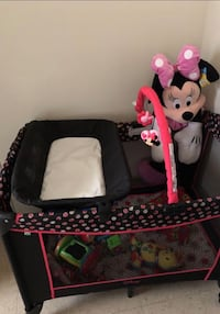 baby's black and pink travel cot