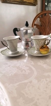 Coffee pot with chip and saucer set